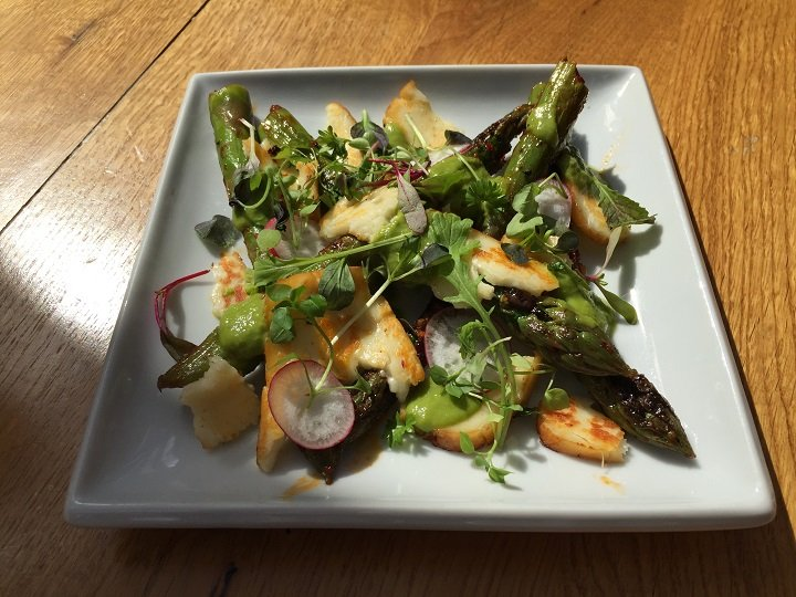 Rose harrisa marinated asparagus with smoked halloumi