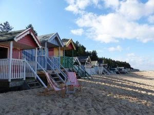 coloured beach huts on the sand