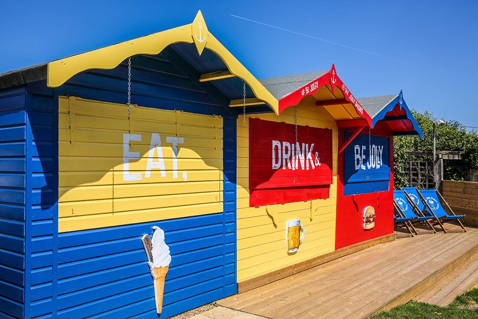 blue yellow and red beach huts
