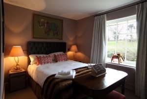 hotel bedroom lamps either side of bed elephant picture above head dark wooden table