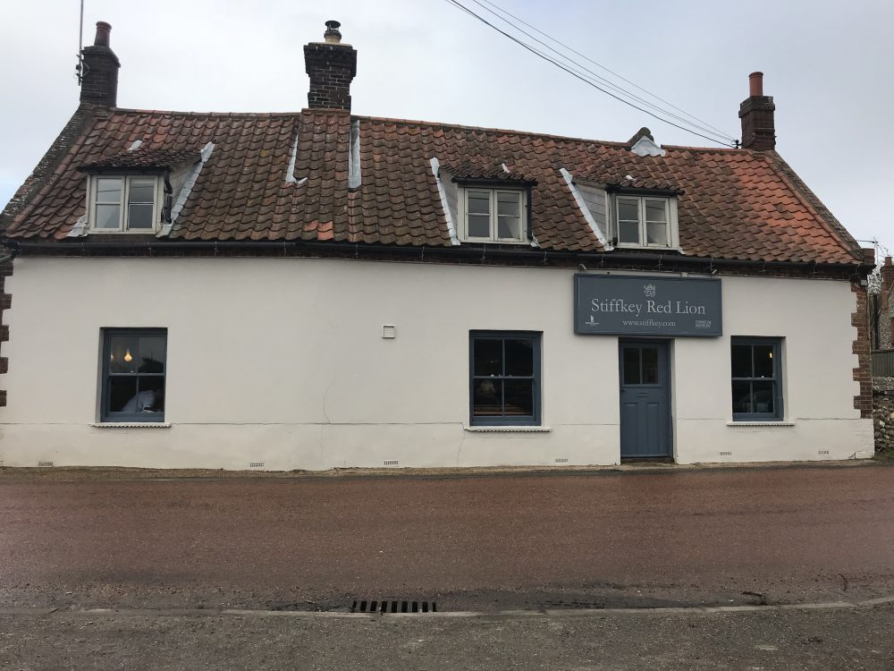white country pub road side with orange tiled roof