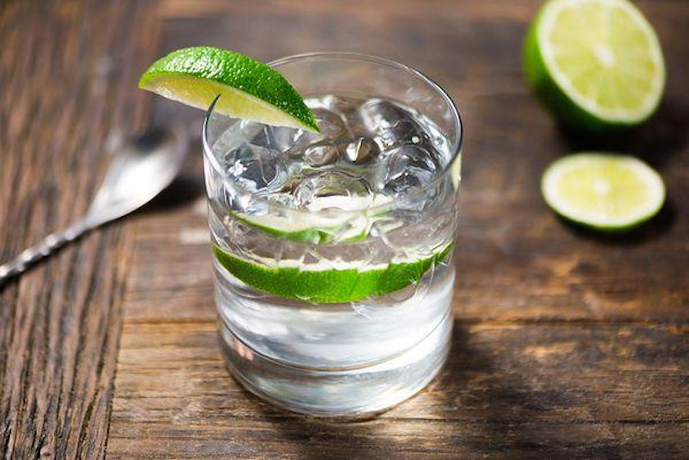 gin glass lime wooden table