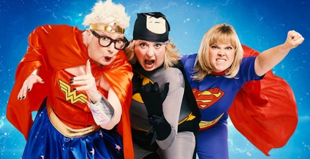 three women in super hero costumes