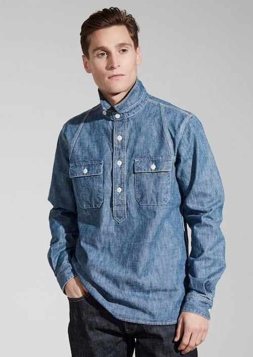 man in denim shirt