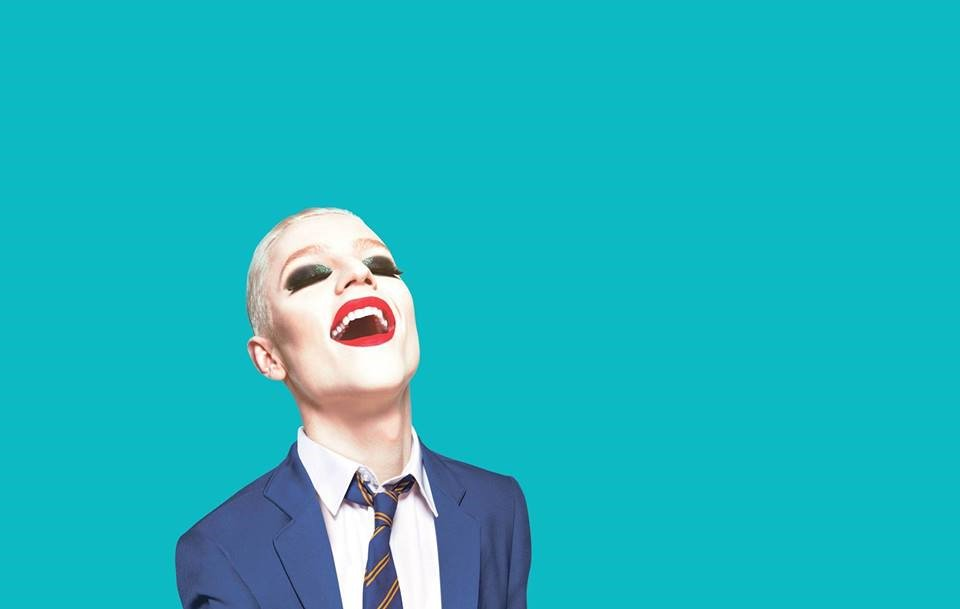 everybody's talking about Jamie man with red lipstick and blonde shaved head