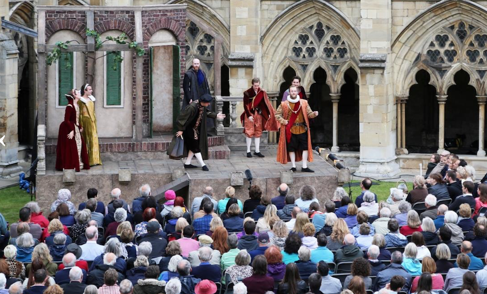 outdoor theatre norwich cathedral Shakespeare tempest crowd of people cloisters