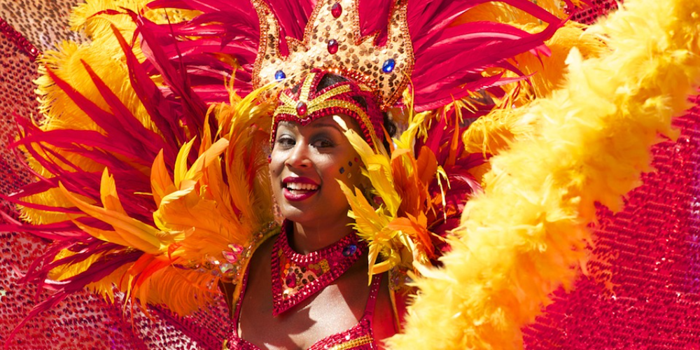 carnival red and orange feather head dress