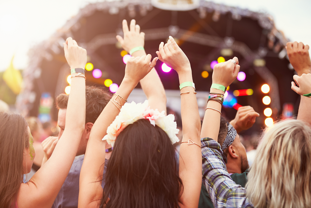 music festival arms waving stage