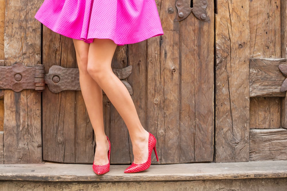 pink skirt ladies legs red stilettos