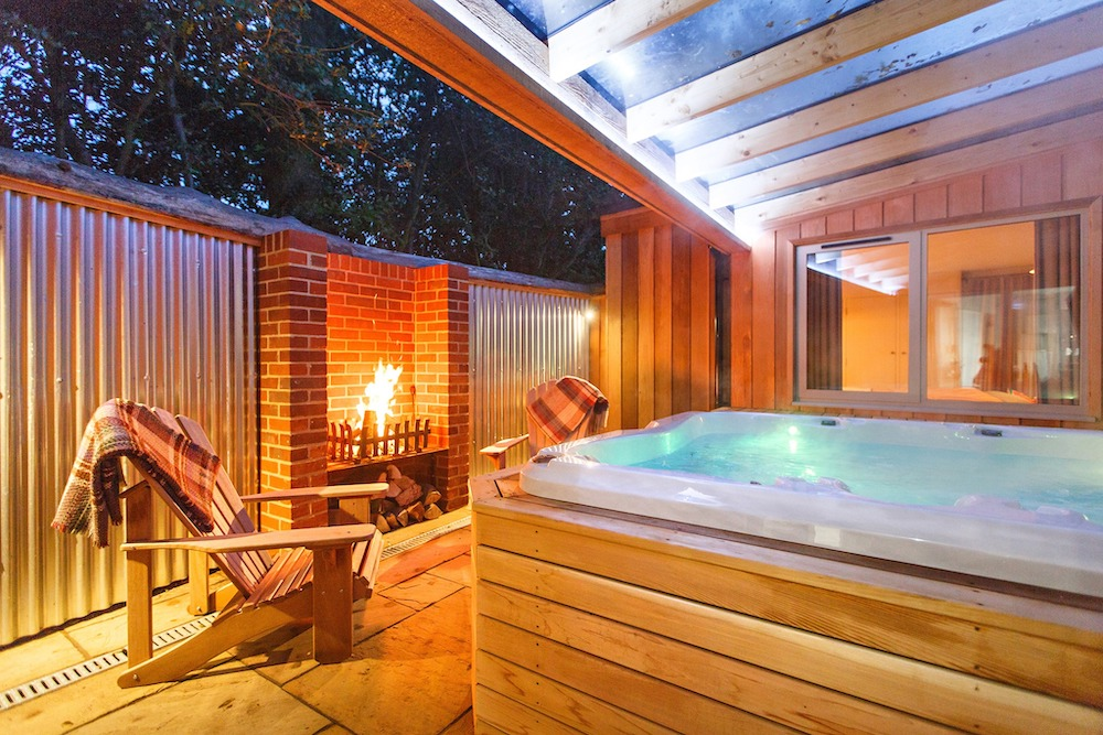 outdoor hot tub on decking and fire pit