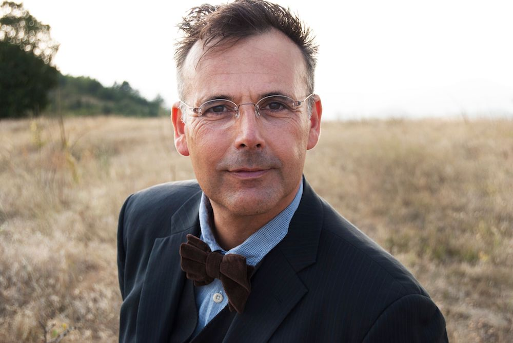 rob newman man in bow tie glasses in field