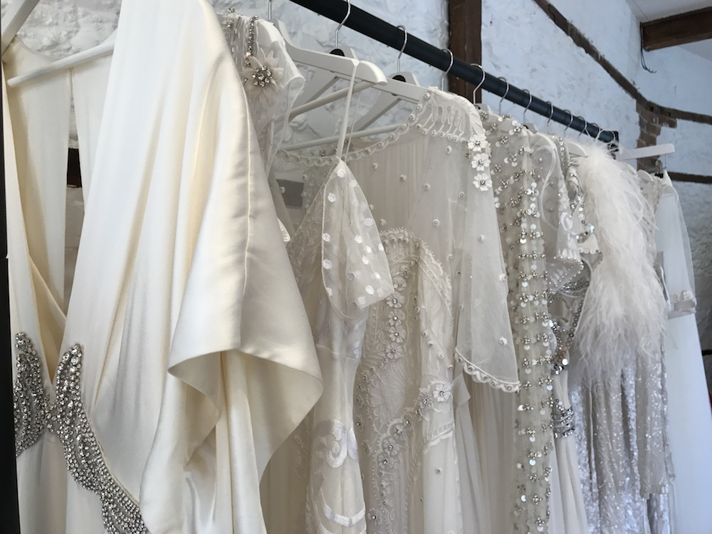 white wedding dresses one a rail