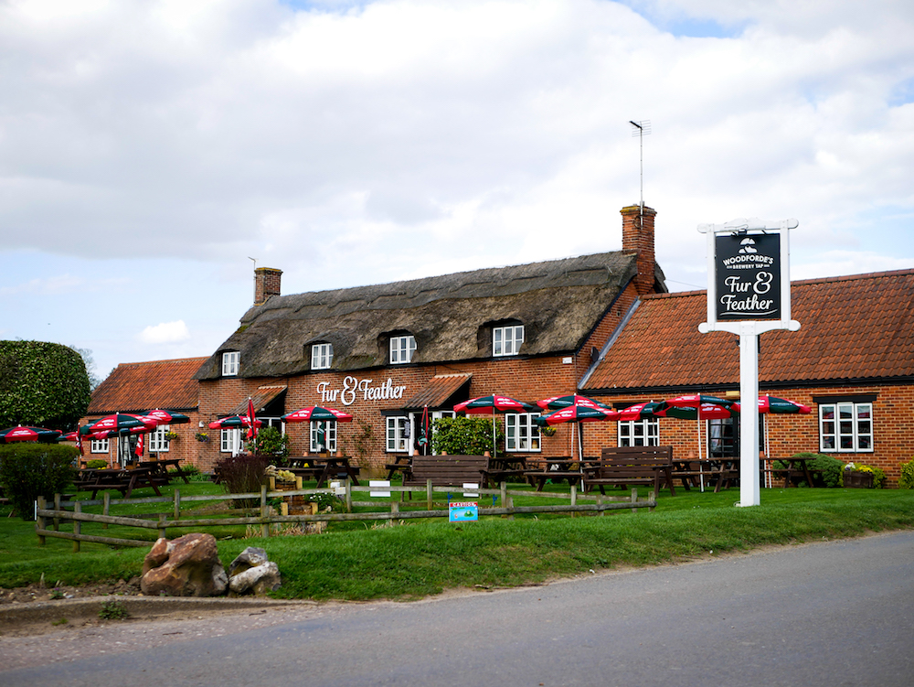 red brick traditional thatched pub garden out front