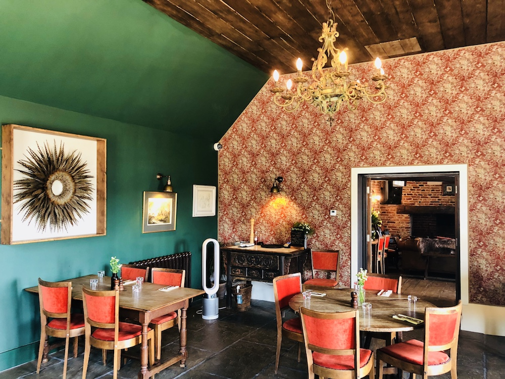 restaurant red chairs green wall pheasant feather picture