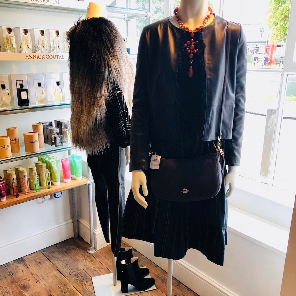mannequin with black leather jacket black skinny fur shrug beauty products