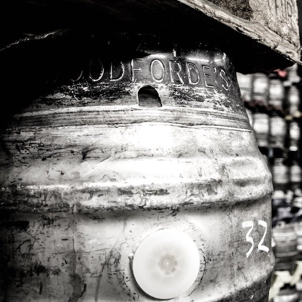 black and white image of a Woodforde's beer barrel