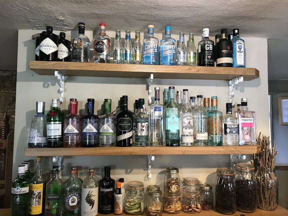 bottles of gin on a bar