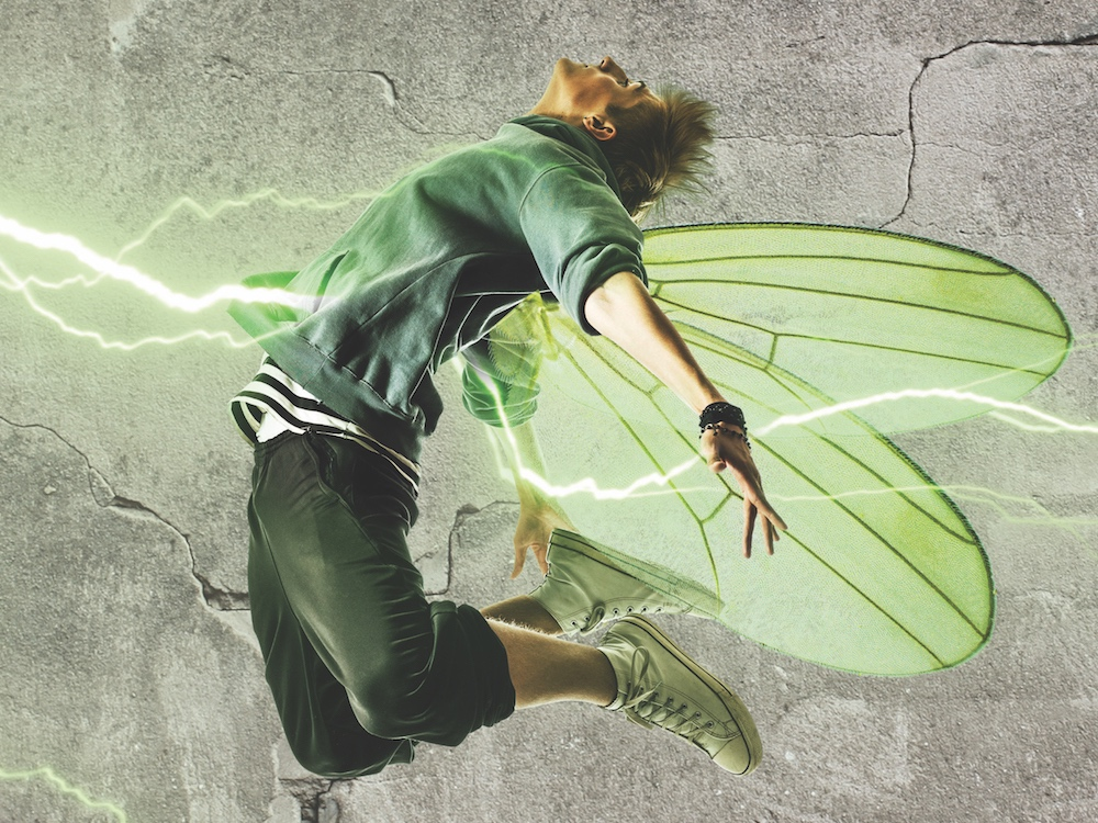 modern day male fairy with green wings sneakers lightening strikes