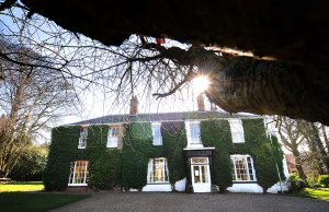 Georgian guest house covered in ivy