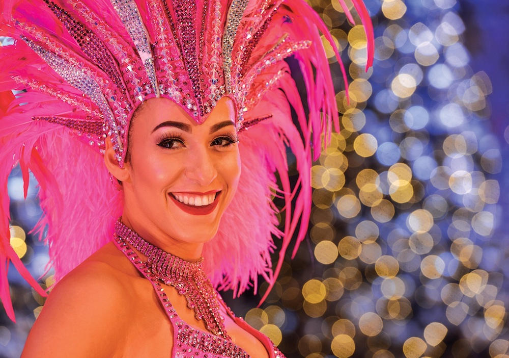 lady in pink feather and sequin headers