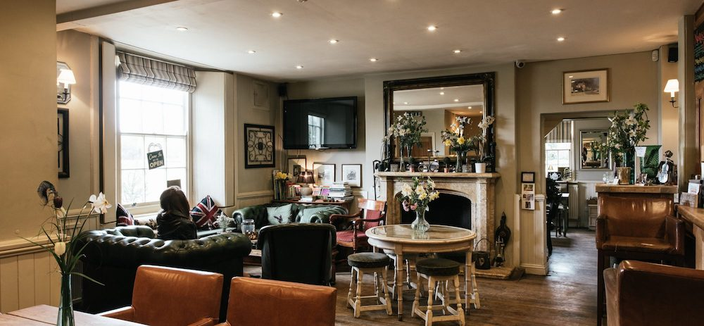 pub interior leather sofas mirror fireplace