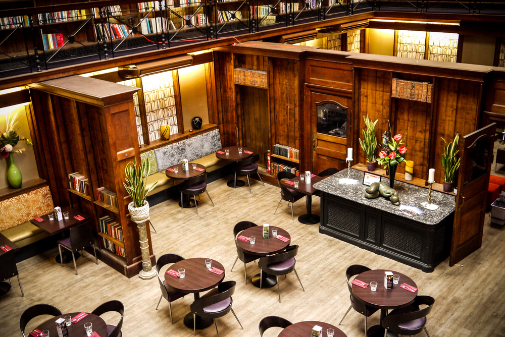 library restaurant wooden tables and chairs bookcases