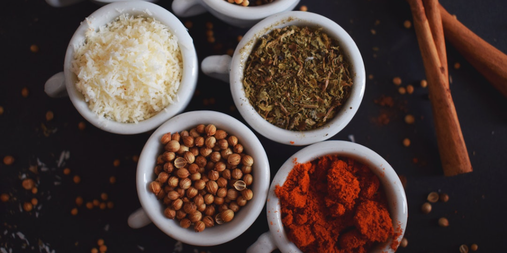 four bowls of different spices
