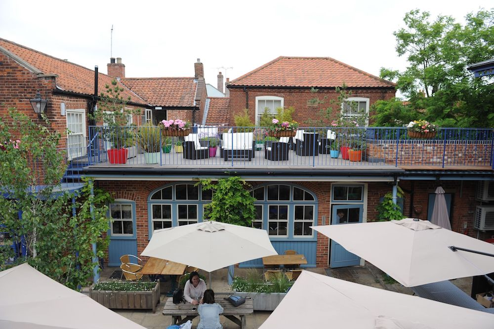 roof terrace and courtyard benches with white parasols