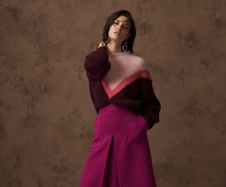 lady in pink and purple jumper