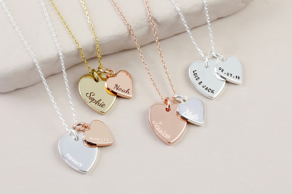 several engraved necklaces in silver gold and rose gold