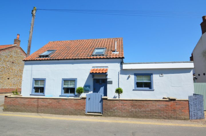 small cottage painted duck egg blue red tile roof velux windows