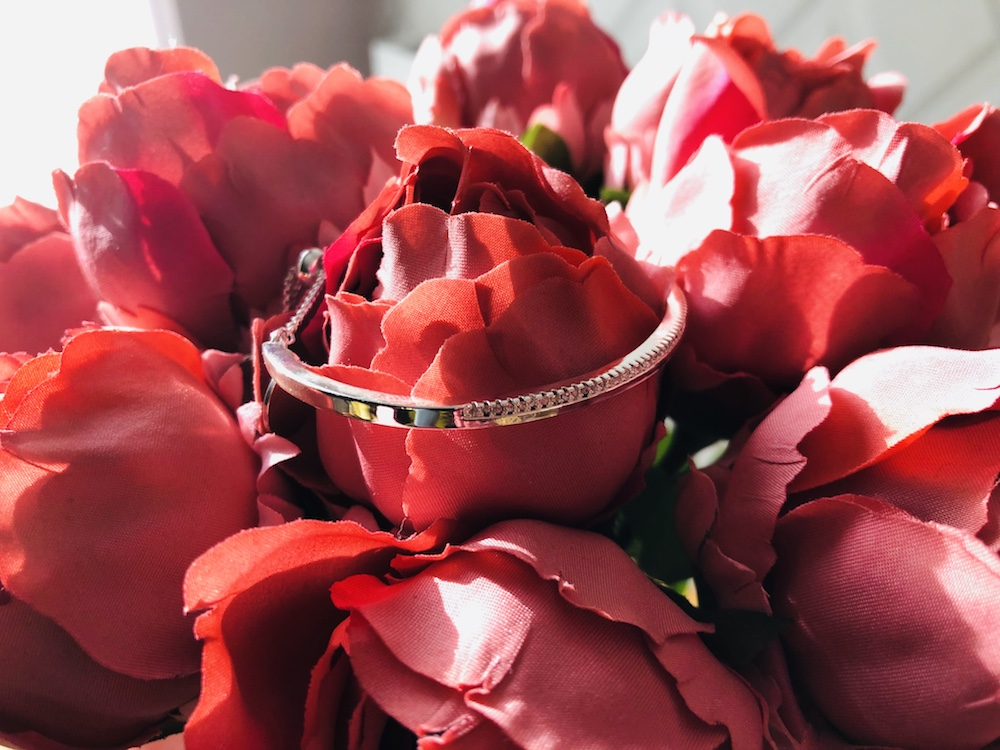 silver bangle on pink roses