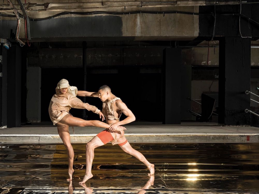 ballet dancers in empty warehouse