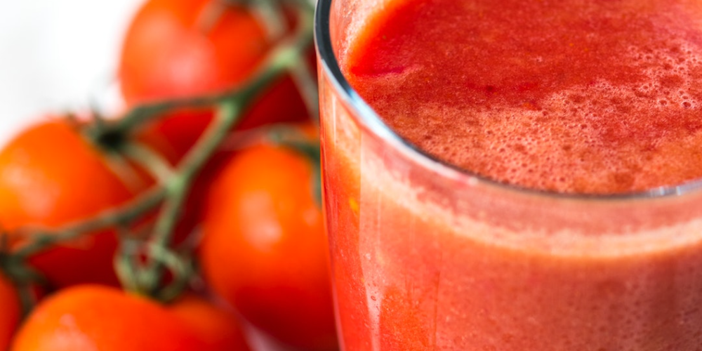 tomato juice in a glass with cherry vive tomatoes