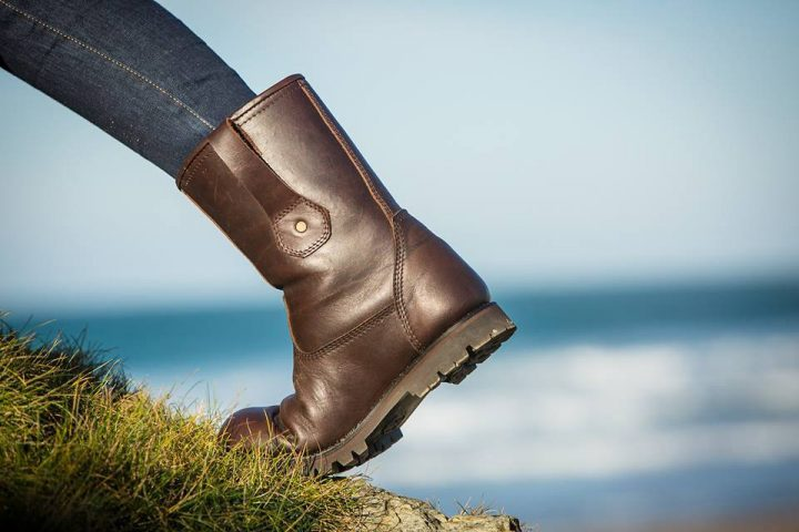brown boots sea back drop