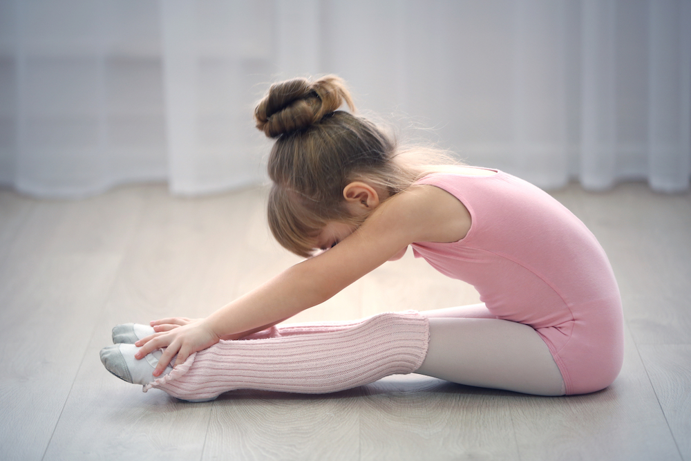 young girl in ballerina leotard