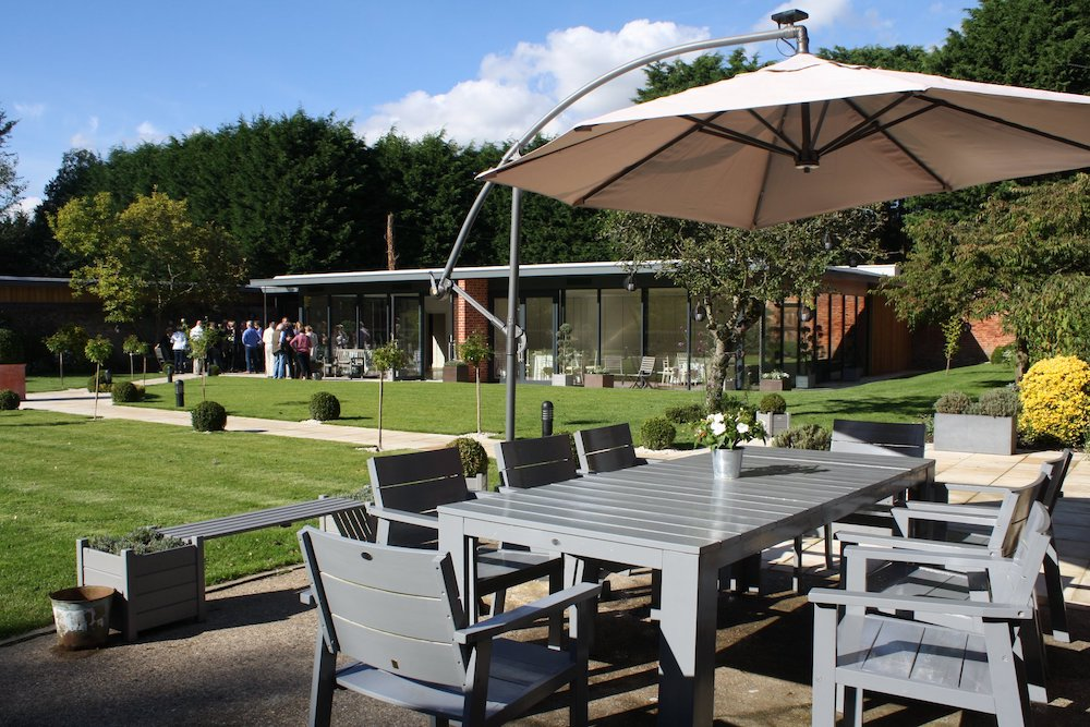 garden with table, chairs and sun canopy