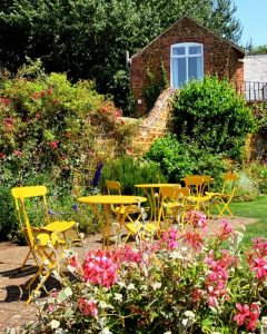 garden flowers yellow table and chairs