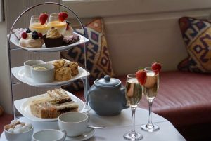 afternoon tea tiered stand, cakes, champagne