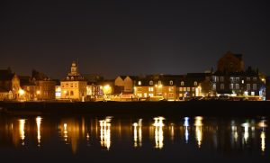 night time view of bank house hotel and docks, glowing lights