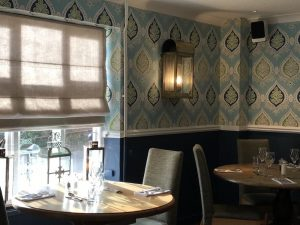 dining room, tables and chairs, geometric blue wall paper