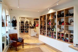 leather shop handbags and shoes on shelves