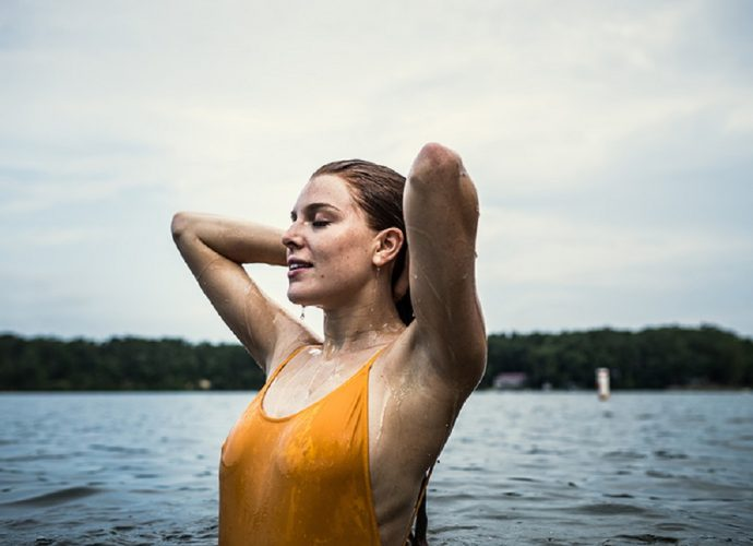 wellbeing, woman wild swimming